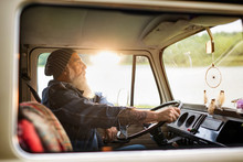 Senior Hipster Driving A Van By Countryside