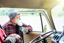 Senior Man Near His Pickup, Ready For A Hike In The Woods