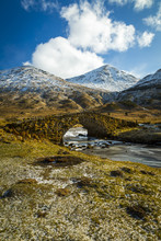 View Of Mountains And Cattle Bridge In Winter, In The Argyll Forest And National Park, Highlands, Scotland