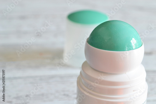 Photo roll-on deodorant with a lid in the background
