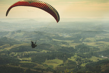 Paraglider Flying On The Beaut...