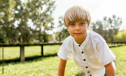 Portrait of a blond child outdoors
