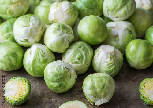 Poster Brussel Raw brussels sprouts on wooden desk.