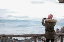 Girl Photographing Winter Scen...