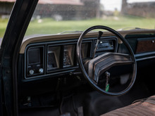 Steering Wheel And Dashboard In A Vintage Truck.