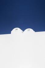 Minimalistic Greek White Architecture And Blue Sky