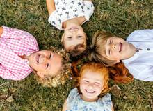 Four Smiling Children Lying On...
