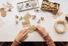 Woman Making Christmas Cards W...
