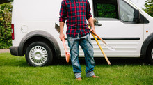 Anonymous Male Gardener With Tools And Van