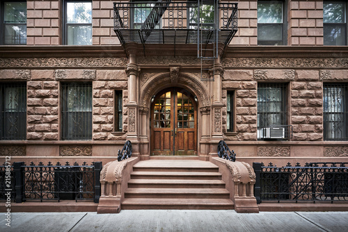 steps leading up to a brownstone building Canvas Print