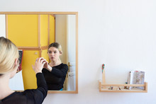 Girl Touching Mirror Surface With Arm.