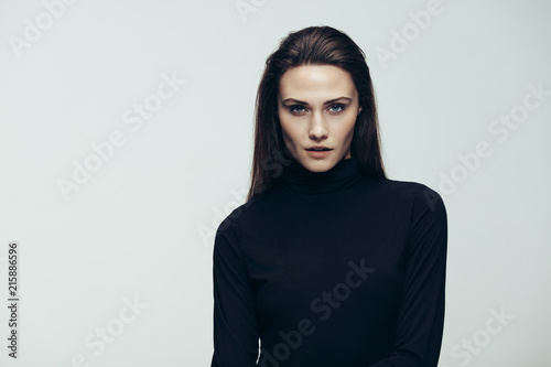 Confident female model in black dress