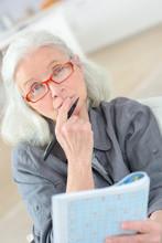 Thoughtful Elderly Woman Doing...