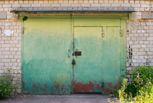 Old Green Metal  Garage Doors With A Lock