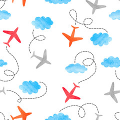 Fototapeta Seamless kid pattern with watercolor planes and clouds.