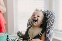 Baby Boy Enjoying His 1st Year Birthday With A Smashcake