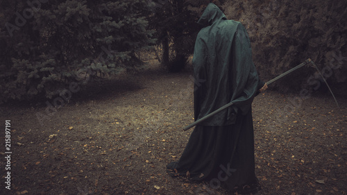 Death, Grim Reaper, with his scythe lurking in the woods in a haunted forest Canvas Print