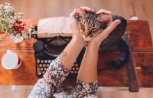 Woman Stroking Her Cat