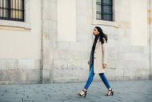 Stylish Woman Walking Through He City.