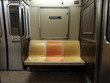 Retro priority seating on subway car.