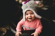 A Happy Baby In A Cat Hat