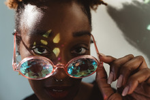 A Young African American Woman Wearing Prismatic Glasses