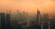 JAKARTA, Indonesia - July 18, 2018: Beautiful aerial shot of Jakarta skyline with skyscrapers, orange sky, and fog at dusk. Shot in 4k resolution