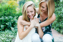 Two Young Girls Laughing And H...