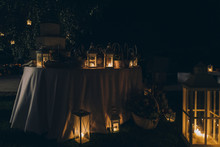 Lanterns And Home Decorations In A Garden At Night