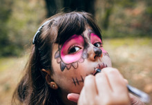 Little Girl Painting Her Face ...