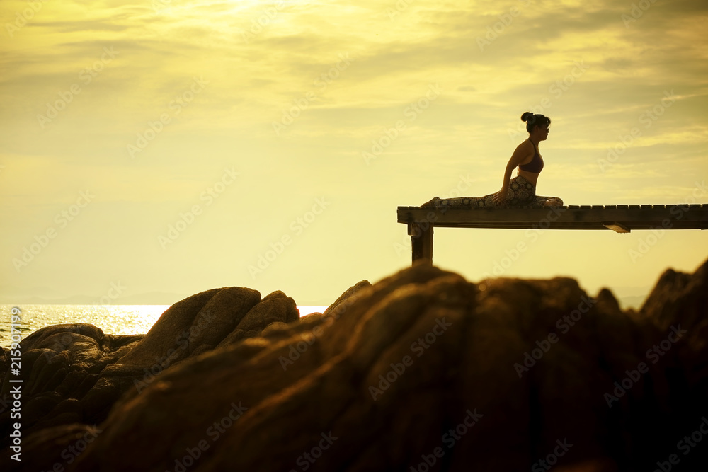 Photo Art Print Woman Playing Yoga Pose On Beach Pier Against