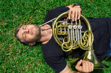 French Horn. A Man In A T-shir...