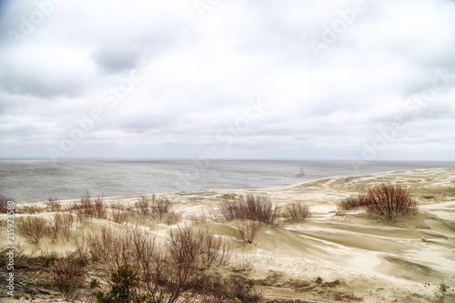 Beautiful view on sand dunes of the Curonian spit. Nida in Lithuania and Kaliningrad region in Russia #215923580