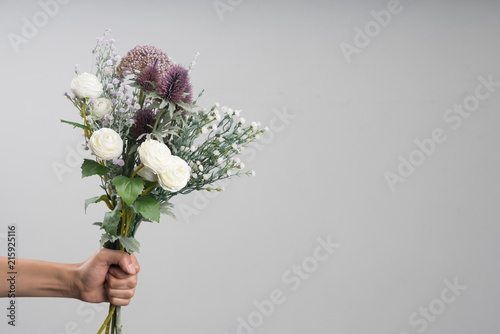 Wall Murals Floral beautiful bouquet of fresh flowers on light background.