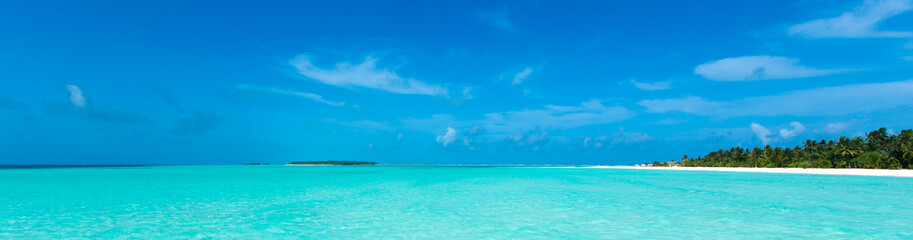 tropical beach in Maldives with blue lagoon