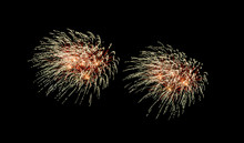 Red And Yellow Fireworks Explosion On Night Sky