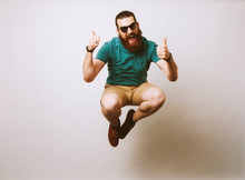 Man Jumping And Showing Thumbs Up