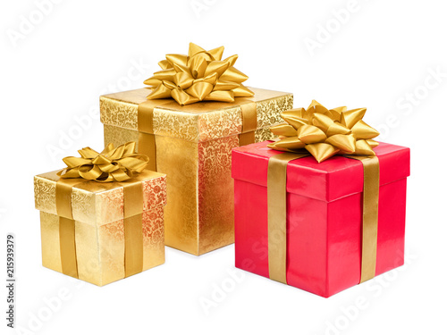 Gold and red gift boxes on white background