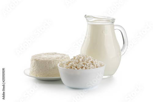 Carta da parati Dairy products. Bowl of cottage cheese and milk isolated on white