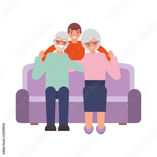 Fototapety, obrazy: grandparents with grandson sitting on sofa