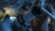 Smart young boy looking through a telescope at night