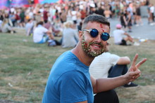 Fancy Male Giving Peace Sign In Crowded Event