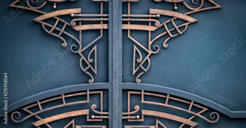 Foto auf Gartenposter Schmetterlinge im Grunge wrought-iron gates, ornamental forging, forged elements close-up