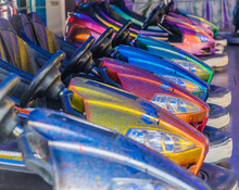 Metallic Shiny Bumper Cars Waiting In A Row