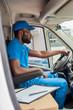 african american delivery man driving van