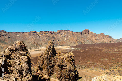 Foto op Aluminium Blauw View of landscape of Teide National Park on Tenerife, Canarias islands, Spain. Yellow and black sand and distance view of mountains roads and volcano.