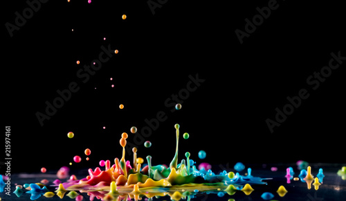 Wall Murals Form Abstract sculptures of colorful splashes of paint. Dancing liquid on a black background. Ink water splash. Color explosion.