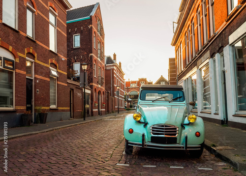Obrazy w stylach a-stylish-retro-car-in-blue-on-the-street-in-the-dutch-city-of-vlaardingen-rotterdam-holland-the-netherlands