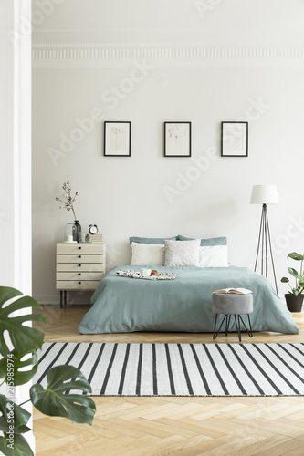 Real Photo Of Bright Bedroom Interior With Three Simple Posters Striped Carpet And Pastel Green