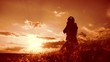 Girl folded her hands in prayer silhouette at sunset. woman praying on her knees. slow motion video. Girl folded lifestyle her hands in prayer pray to God. the girl praying asks forgiveness for sins